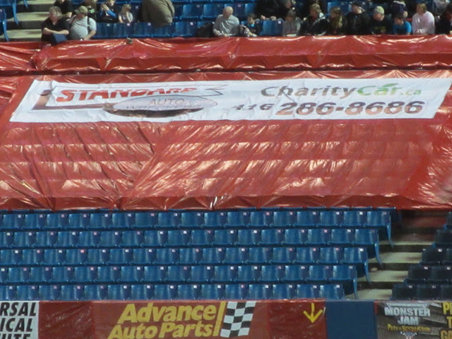 charity car and saw sponsor banner